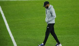 Montreal Impact head coach Thierry Henry exits the field after his team lost 3-1 to New York City FC during their MLS match, Saturday, Oct. 24, 2020, at Yankee Stadium in New York. (AP Photo/Eduardo Munoz Alvarez)