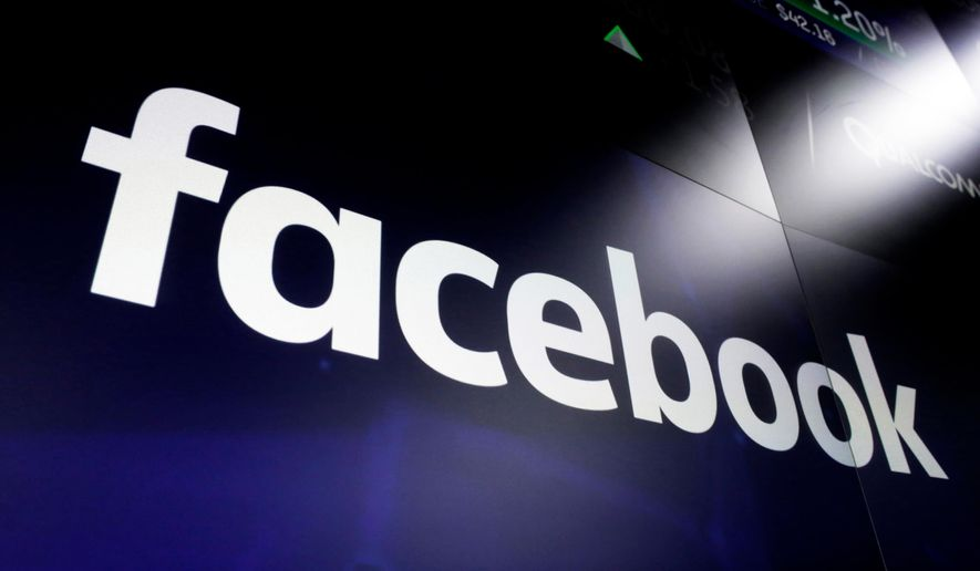 In this March 29, 2018, file photo, the Facebook logo on a screen at Nasdaq in Time Square, New York.  (AP Photo/Richard Drew, File) **FILE**