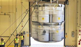 FILE - In this April 2019, file photo, provided by Los Alamos National Laboratory, barrels of radioactive waste are loaded for transport to the Waste Isolation Pilot Plant (WIPP) at the Radioactive Assay Nondestructive Testing (RANT) facility in Los Alamos, N.M. New Mexico is going after the federal government for failing to make progress on cleaning up contamination left behind by decades of bomb-making and nuclear research at one of the nation's premier nuclear labs. In a civil complaint filed in federal court, the state says the plan by the U.S. Energy Department lacks substantive and appropriate targets for dealing with waste at Los Alamos National Laboratory. (Nestor Trujillo/Los Alamos National Laboratory via AP, File)