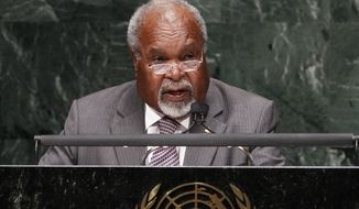 FILE - In this Sept. 27, 2010, file photo, Michael Somare, Prime then Minister of Papua New Guinea addresses the 65th session of the United Nations General Assembly at U.N. headquarters.  Somare, a pivotal figure in Papua New Guinea's independence and the South Pacific island nation's first prime minister, has died. He was 84. He died Friday, Feb. 26, 2021, after being diagnosed with a late-stage pancreatic cancer and admitted to a hospital on Feb. 19, his daughter Betha Somare said. (AP Photo/Seth Wenig, File)
