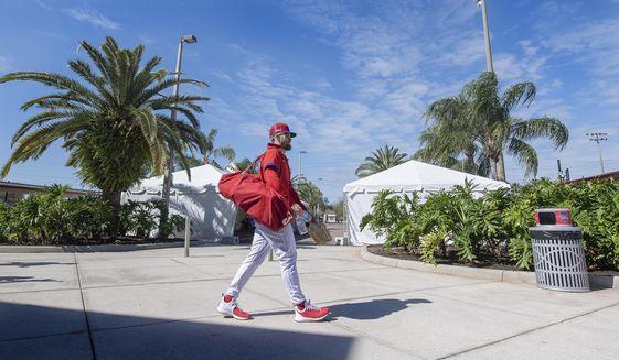 Philadelphia Phillies' Bryce Harper walks to batting practice during spring training baseball practice in Clearwater, Fla., Thursday, Feb. 25, 2021. (Jose F. Moreno/The Philadelphia Inquirer via AP)
