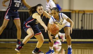 Connecticut guard Nika Muhl (10) knocks the ball away from Creighton guard DeArica Pryor (3) in the fourth quarter during an NCAA college basketball game Thursday, Feb. 25, 2021, in Omaha, Neb. (AP Photo/John Peterson)