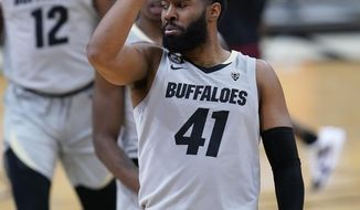 Colorado forward Jeriah Horne reacts after hitting a 3-point-basket against Southern California during the first half of an NCAA college basketball game Thursday, Feb. 25, 2021, in Boulder, Colo. (AP Photo/David Zalubowski)