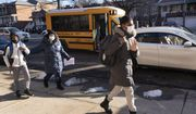 Students arrive at Meyer Levin Middle School, Thursday, Feb. 25, 2021, in New York. In-school learning resumed for middle school students in New York City for the first time since the fall of 2020. (AP Photo/Mark Lennihan)