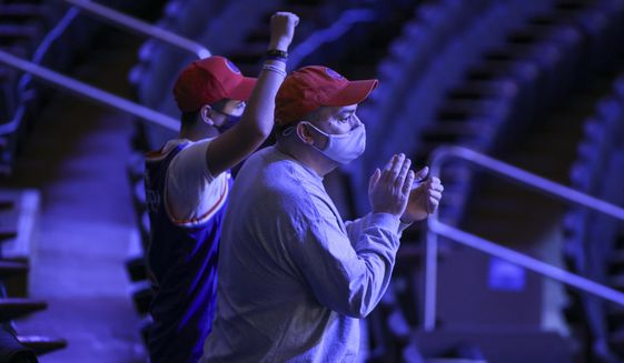 Fans cheer the New York Knicks coming out to warm up for an NBA basketball game against the Golden State Warriors on Tuesday, Feb. 23, 2021, in New York. A limited number of fans were allowed to attend. (Wendell Cruz/Pool Photo via AP)  **FILE**