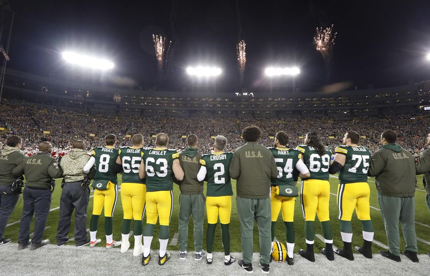 FILE - Players and veterans line up for the national anthem before an NFL football game between the Green Bay Packers and the Detroit Lions in Green Bay, Wisc., in this Nov. 6, 2017, file photo. The national anthem would have to be played before all sporting events at Lambeau Field, the Fiserv Forum and all other Wisconsin venues that have received taxpayer money under a bill introduced Thursday, Feb. 25, 2021, in the state Legislature by a Republican lawmaker.  (AP Photo/Mike Roemer, File)
