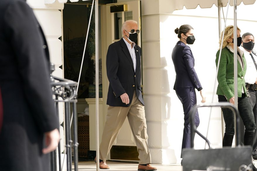 President Joe Biden and first lady Jill Biden, walk out of the White House to board Marine One at the White House in Washington, Friday, Feb. 26, 2021, for a short trip to Andrews Air Force Base, Md., and then on to Houston. (AP Photo/Andrew Harnik)