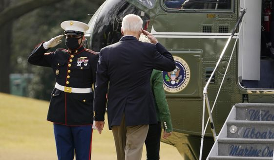 President Joe Biden salutes before boarding Marine One with first lady Jill Biden at the White House in Washington, Friday, Feb. 26, 2021, for a short trip to Andrews Air Force Base, Md., and then on to Houston. (AP Photo/Andrew Harnik)
