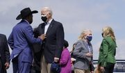 President Joe Biden speaks with Houston Mayor Sylvester Turner as first lady Jill Biden, right, speaks with Rep. Sylvia Garcia, D-Texas, after stepping off Air Force One at Ellington Field Joint Reserve Base in Houston, Friday, Feb. 26, 2021. (AP Photo/Patrick Semansky)