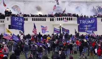 In this Wednesday, Jan. 6, 2021, file photo, violent rioters supporting President Donald Trump, storm the Capitol in Washington. A faction of local, county and state Republican officials across the country is pushing lies, misinformation and conspiracy theories online that echo those that helped inspire the violent Capitol insurrection, forcing the GOP into an internal reckoning.. (AP Photo/John Minchillo, File)