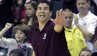 FILE - In this Nov. 28, 2010, file photo, then Texas A&M assistant coach Scott Spinelli calls to players during an NCAA college basketball game against Temple in Lake Buena Vista, Fla. Spinelli will take over as Boston College's interim men's basketball head coach against Notre Dame on Saturday Feb. 27, 2021. (AP Photo/John Raoux)