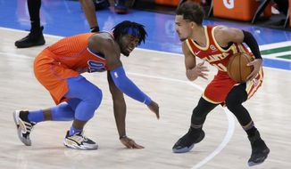 Atlanta Hawks guard Trae Young (11) is defended by Oklahoma City Thunder forward Luguentz Dort during the first half of an NBA basketball game Friday, Feb. 26, 2021, in Oklahoma City. (AP Photo/Garett Fisbeck)