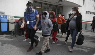 A migrant family crosses the border into El Paso, Texas, in Ciudad Juarez, Mexico, Friday, Feb. 26, 2021. After waiting months and sometimes years in Mexico, people seeking asylum in the United States are being allowed into the country as they wait for courts to decide on their cases, unwinding one of the Trump administration's signature immigration policies that President Joe Biden vowed to end. (AP Photo/Christian Chavez)