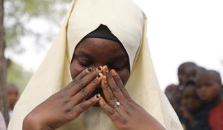 One of the students who was not kidnapped from a Government Girls Junior Secondary School following an attack by gunmen in Jangebe, Nigeria, Friday, Feb. 26, 2021.  Gunmen abducted 317 girls from a boarding school in northern Nigeria on Friday, police said, the latest in a series of mass kidnappings of students in the West African nation. (AP Photo/ Ibrahim Mansur)