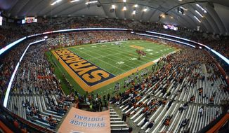 FILE - In this Nov. 9, 2018, file photo, the second half of an NCAA college football game between Syracuse and Louisville is played in the Carrier Dome in Syracuse, N.Y.  The 49,000-seat stadium, which serves as home of Syracuse's football and basketball programs, opened in 1980 with a name tied to a large donation made by the heating and air conditioning conglomerate. While the field now carries the name of Ernie Davis, college football's first Black Heisman Trophy winner, the entire facility should be renamed the Jim Brown Dome. (AP Photo/Adrian Kraus, File)