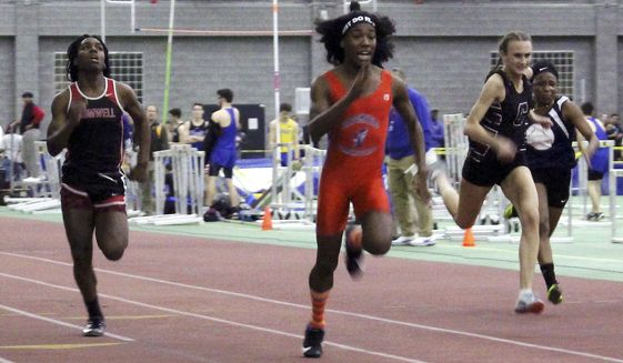 FILE — In this Feb. 7, 2019 file photo, Bloomfield High School transgender athlete Terry Miller, second from left, wins the final of the 55-meter dash over transgender athlete Andraya Yearwood, left, and other runners in the Connecticut girls Class S indoor track meet at Hillhouse High School in New Haven, Conn. Lawyers for several Connecticut school districts and the organization that oversees high school sports in the state went before a federal judge Friday, Feb. 26, 2021, seeking the dismissal of a lawsuit that would prevent transgender girls from competing in girl's sports. (AP Photo/Pat Eaton-Robb, File)