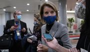 Sen. Shelley Moore Capito, R-W.Va., walks on Capitol Hill in Washington, Thursday, Feb. 11, 2021, before the start of the third day of the second impeachment trial of former President Donald Trump. (AP Photo/Susan Walsh) ** FILE **
