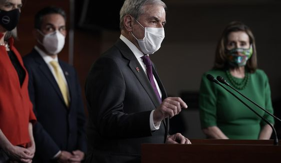 House Budget Committee Chairman John Yarmuth, D-Ky., speaks meets with reporters before the House votes to pass a $1.9 trillion pandemic relief package, during a news conference at the Capitol in Washington, Friday, Feb. 26, 2021. House Speaker Nancy Pelosi of Calif., is at right. (AP Photo/J. Scott Applewhite) ** FILE **