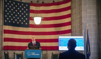 Nebraska state Governor Pete Ricketts gives an update to the public during a weekly COVID-19 press conference at the Nebraska State Capitol Friday, Feb. 26, 2021, in Lincoln, Neb. (Kenneth Ferriera/Lincoln Journal Star via AP)