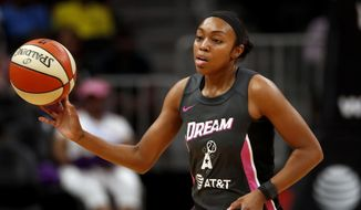 FILE - Atlanta Dream guard Renee Montgomery (21) passes the ball in the first half of a WNBA basketball game against the Chicago Sky in Atlanta, in this Tuesday, Aug. 20, 2019, file photo. Larry Gottesdiener has been approved as the head of a new three-member ownership group of the WNBA's Atlanta Dream following pressure on former Sen. Kelly Loeffler to sell her share of the team. Friday's, Feb. 26, 2021, unanimous approval of the sale to Gottesdiener means co-owner Mary Brock also sold her share of the team, which will remain in Atlanta. Gottesdiener is chairman of the real estate firm Northland. The three-member investor group also includes former Dream guard Renee Montgomery and Northland president Suzanne Abair.(AP Photo/John Bazemore, File)