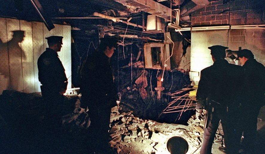 FILE - In this Feb. 27, 1993, file photo, Port Authority and New York City Police officers view the damage caused by a truck bomb that exploded in the garage of New York's World Trade Center the previous day. Decades after going to prison, some of the men responsible for the World Trade Center bombing that killed six people 28 years ago Friday, Feb. 26, 2021, are still trying to whittle down their onetime life sentences on the remote chance that they could someday be freed. (AP Photo/Richard Drew, File)