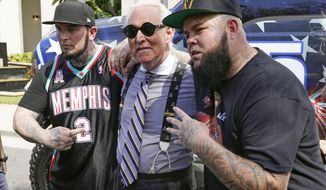 Conservative political consultant, Roger Stone poses for photos outside the convention center at the Conservative Political Action Conference (CPAC) Saturday, Feb. 27, 2021, in Orlando, Fla. (AP Photo/John Raoux)