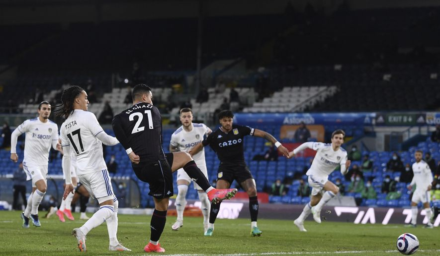 Aston Villa's Anwar El Ghazi, 3rd from left, scores the opening goal during an English Premier League soccer match between Leeds United and Aston Villa at the Elland Road Stadium in Leeds, England, Saturday Feb. 27, 2021. (Laurence Griffiths/Pool via AP)