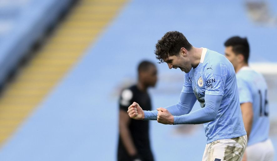 Manchester City's John Stones celebrates at the end of the English Premier League soccer match between Manchester City and West Ham United at the Etihad stadium in Manchester, England, Saturday, Feb. 27, 2021. (Gareth Copley/Pool via AP)