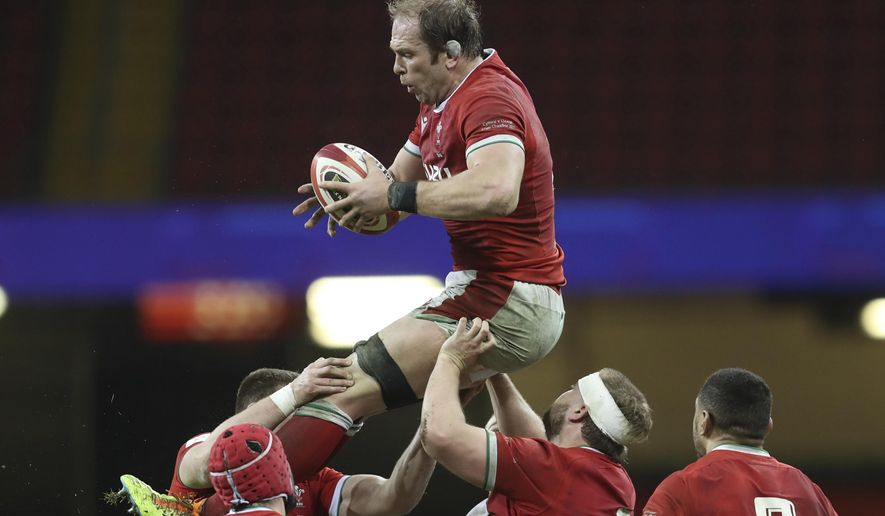 Wales' Alun Wyn Jones gathers the ball in a line out during the Six Nations rugby union match between Wales and England at the Millennium stadium in Cardiff, Wales, Saturday, Feb. 27, 2021. (David Davies/Pool Via AP)
