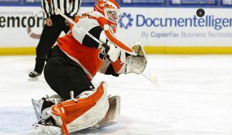 Philadelphia Flyers goalie Brian Elliott (37) makes a save during the second period of an NHL hockey game against the Buffalo Sabres, Saturday, Feb. 27, 2021, in Buffalo, N.Y. (AP Photo/Jeffrey T. Barnes)