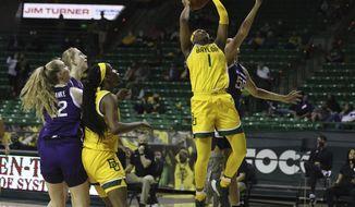 Baylor forward NaLyssa Smith scores over Kansas State center Ayoka Lee, right, in the first half of an NCAA college basketball game, Saturday, Feb. 27, 2021, in Waco, Texas. (Rod Aydelotte/Waco Tribune Herald via AP)