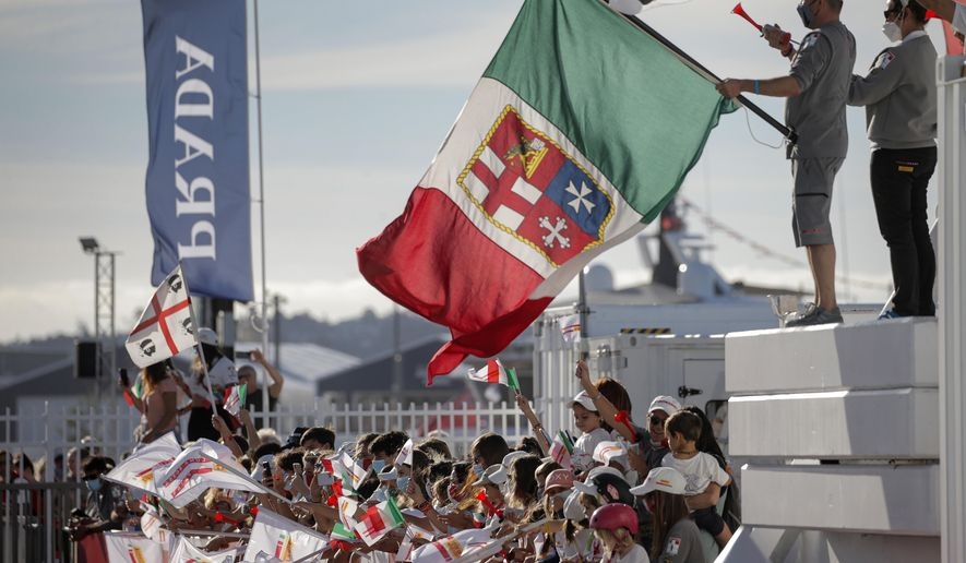 Supporters of Italy's Luna Rossa team join in the celebration after defeating Britain's INEOS Team UK in race eight of the Prada Cup on Auckland's Waitemata Harbour, New Zealand, Sunday, Feb.21, 2021.Italian challenger Luna Rossa Prada Pirelli will race defender Emirates Team New Zealand in the 36th match for the America's Cup after beating Britain's Ineos Team UK in two races Sunday to seal a 7-1 win in the best-of-13 race challengers series final. (Alex Burton/NZ Herald via AP)