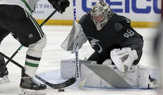 Tampa Bay Lightning goaltender Andrei Vasilevskiy, of Russia, makes a save during the third period of the team's NHL hockey game against the Dallas Stars on Saturday, Feb. 27, 2021, in Tampa, Fla. (AP Photo/Mike Carlson)