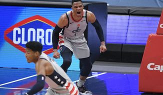 Washington Wizards guard Russell Westbrook (4) reacts after he made a basket during the second half of an NBA basketball game against the Minnesota Timberwolves, Saturday, Feb. 27, 2021, in Washington. (AP Photo/Nick Wass)