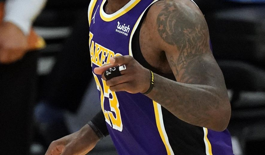 Los Angeles Lakers forward LeBron James (23) points at a team mate during the second half of an NBA basketball game against the Portland Trail Blazers Friday, Feb. 26, 2021, in Los Angeles. (AP Photo/Mark J. Terrill)