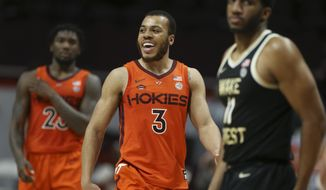 Virginia Tech's Wabissa Bede (3) celebrates a score during the second half against Wake Forest in an NCAA college basketball game Saturday, Feb. 27, 2021, in Blacksburg, Va. (Matt Gentry/The Roanoke Times via AP, Pool)