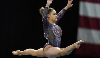 Laurie Hernandez performs in the floor exercise during the Winter Cup gymnastics competition, Saturday, Feb. 27, 2021, in Indianapolis. (AP Photo/Darron Cummings)