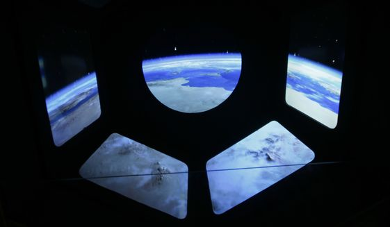 A reproduction of the view of the earth from a spaceship is displayed at the museum of the science and technologies in Milan, Italy, Friday, Feb. 12, 2016. Scientists announced they have finally detected gravitational waves, the ripples in the fabric of space-time that Einstein predicted a century ago. The announcement has electrified the world of astronomy, and some have likened the breakthrough to the moment Galileo took up a telescope to look at the planets. (AP Photo/Luca Bruno)