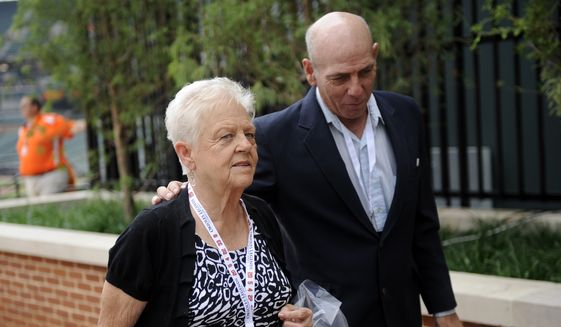 In a Thursday, Sept. 6, 2012 file photo, Vi Ripken, left, mother of former Baltimore Orioles legend and member of the Major League Baseball hall of fame, Cal Ripken, Jr., arrives at a ceremony to unveil his statue before a baseball game against the New York Yankees, in Baltimore. (AP Photo/Nick Wass, File) **FILE**