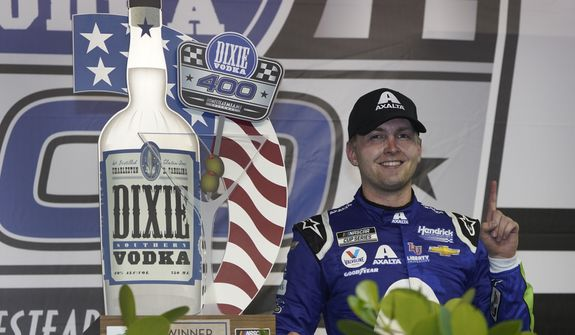 William Byron celebrates after winning a NASCAR Cup Series auto race, Sunday, Feb. 28, 2021, in Homestead, Fla. (AP Photo/Wilfredo Lee)