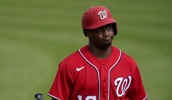 Washington Nationals' Victor Robles heads back to the dugout after striking out during the fourth inning of a spring training baseball game against the St. Louis Cardinals Sunday, Feb. 28, 2021, in Jupiter, Fla. (AP Photo/Jeff Roberson) **FILE**