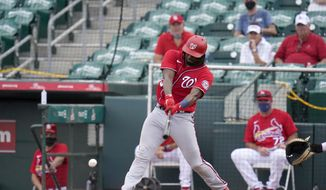Washington Nationals' Josh Bell singles during the fifth inning of a spring training baseball game against the St. Louis Cardinals Sunday, Feb. 28, 2021, in Jupiter, Fla. (AP Photo/Jeff Roberson)