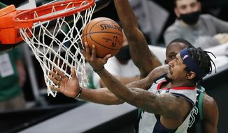 Washington Wizards' Bradley Beal plays against the Boston Celtics during the second half of an NBA basketball game, Sunday, Feb. 28, 2021, in Boston. (AP Photo/Michael Dwyer)