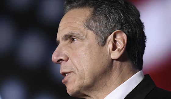 """In this Monday, Jan. 11, 2021, file photo, New York Gov. Andrew Cuomo delivers his State of the State address virtually from The War Room at the state Capitol, in Albany, N.Y. On Sunday, Feb. 28, 2021, Cuomo acknowledged for the first time that some of his behavior with women had been """"misinterpreted as unwanted flirtation,"""" and he would cooperate with a sexual harassment investigation led by the state's attorney general. (AP Photo/Hans Pennink, Pool, File)"""