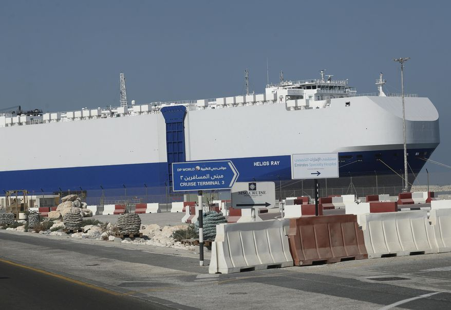 The Israeli-owned cargo ship, Helios Ray, sits docked in port after arriving earlier in Dubai, United Arab Emirates, Sunday, Feb. 28, 2021. The ship has been damaged by an unexplained blast at the gulf of Oman on Thursday. (AP Photo/Kamran Jebreili)