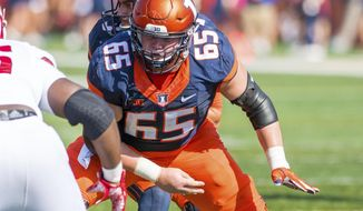 FILE - In this Oct. 14, 2017, file photo, Illinois offensive lineman Doug Kramer (65) blocks during an NCAA college football game against Rutgers in Champaign, Ill. For a program that has not had a winning record since 2011 and has reached the postseason just twice in that time, the hope is that Alex Palczewski, fellow linemen Kramer and Vederian Lowe and the super class will power a long awaited breakthrough in Champaign. (AP Photo/Bradley Leeb, File)