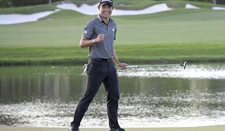 Collin Morikawa celebrates after putting on the 18th green to win the Workday Championship golf tournament Sunday, Feb. 28, 2021, in Bradenton, Fla. (AP Photo/Phelan M. Ebenhack)