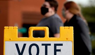 """The Supreme Court will hear a challenge to two Arizona laws. The case concerns """"ballot harvesting"""" and out-of-precinct voting. (Associated Press)"""