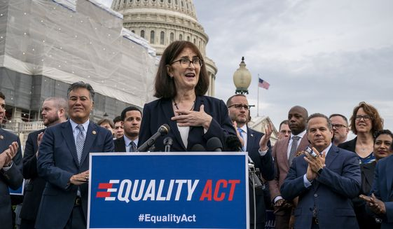 """Transgender rights activist Mara Keisling joins advocates for LGBTQ rights as they rally before a vote in the House on the """"Equality Act of 2019,"""" sweeping anti-discrimination legislation that would extend civil rights protections to LGBT people by prohibiting discrimination based on sexual orientation or gender identity, at the Capitol in Washington, Friday, May 17, 2019. (AP Photo/J. Scott Applewhite)"""