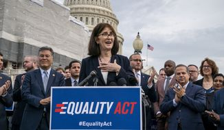 "Transgender rights activist Mara Keisling joins advocates for LGBTQ rights as they rally before a vote in the House on the ""Equality Act of 2019,"" sweeping anti-discrimination legislation that would extend civil rights protections to LGBT people by prohibiting discrimination based on sexual orientation or gender identity, at the Capitol in Washington, Friday, May 17, 2019. (AP Photo/J. Scott Applewhite)"